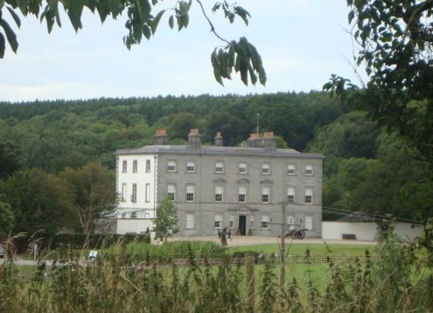 Oldbridge House, Co Meath; large stone house with a green hill in background